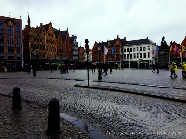 Fellow soaked tourists taking in the sights at the Markt.
