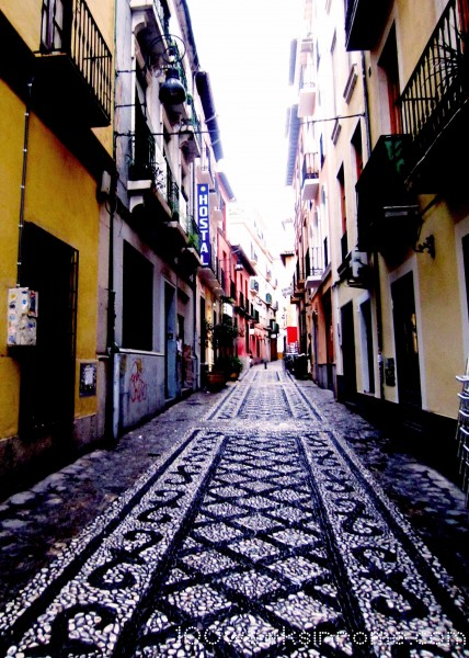 Typical side street in Granada.  The whole city is carpeted in shell patterns.