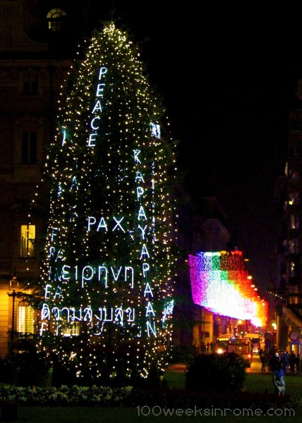 Christmas Tree in Piazza Venezia with Peace written in different languages.