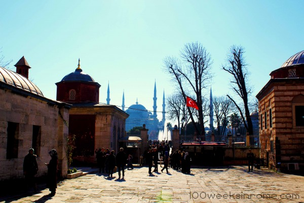 On the grounds of Hagia Sophia looking at the Blue Mosque in the distance.