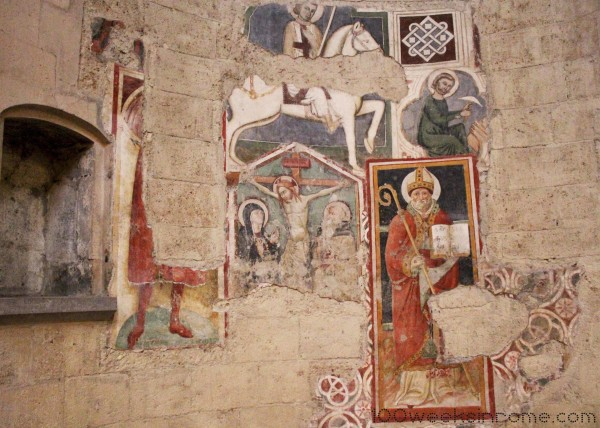 It looks like areas along the nave used to be covered in frescoes.  I don't know why they are so damaged, but I find what is remaining fascinating.  They really put the origins of the cathedral into context.  A time when the templar knights were a reality and not a memory.